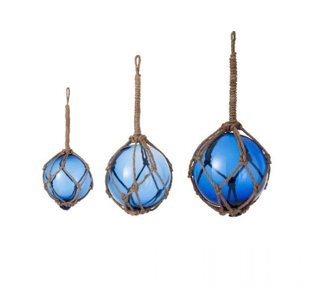 Palla di vetro blu in rete da pesca